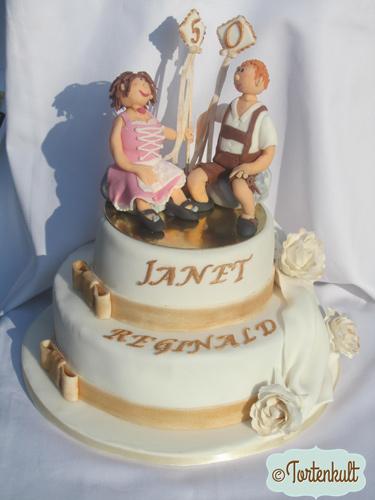 Goldene Hochzeitstorte für ein englisches Paar das in Bayern gefeiert haben